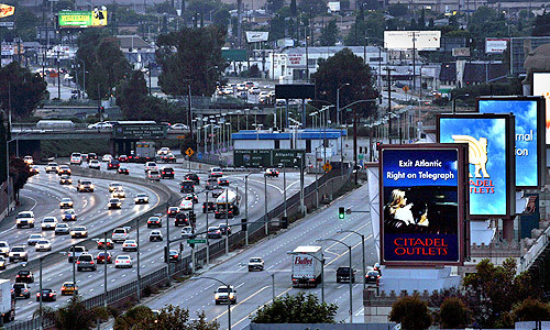 Giant electronic billboards are seen at the Citadel outlet shopping center in Commerce along the 5 Freeway in 2005. (Los Angeles Times)