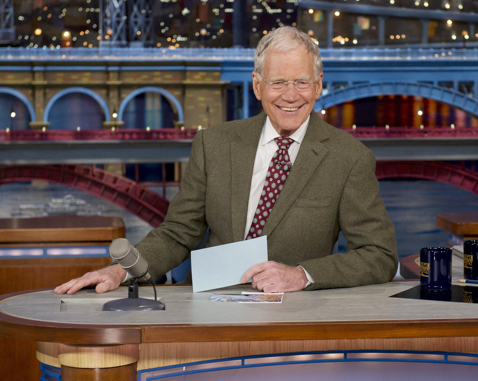 David Letterman Sits At His Late Show Desk During The Broadcast In Which He