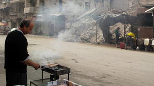 In Syria, a shrinking city struggles on between terrifying air raids