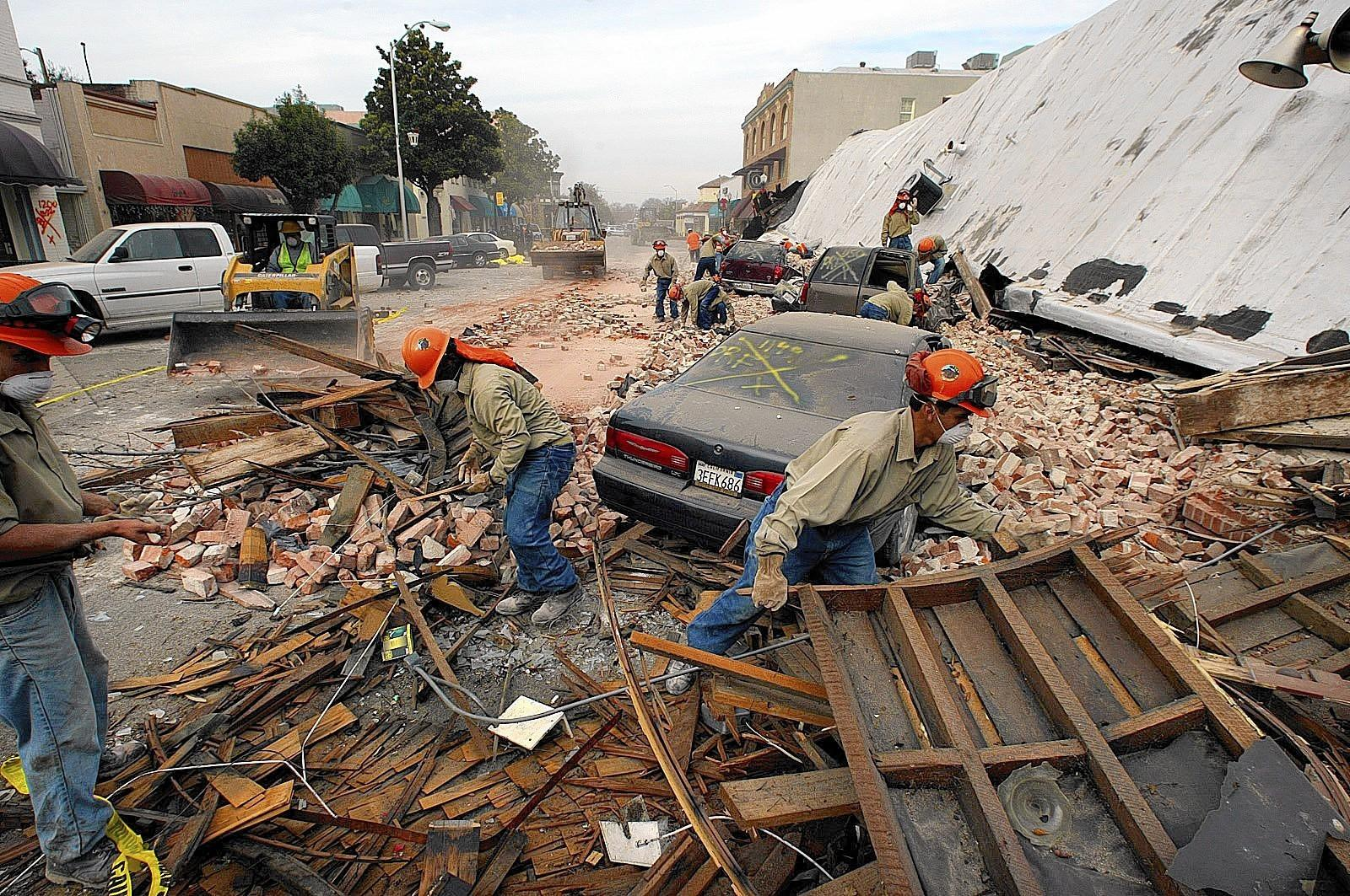 Rescue workers sift through debris in the wake of the 2003 Paso Robles earthquake. The families of the two women killed by falling bricks and plaster in an old building sued the property owners. A jury awarded the families nearly $2 million.
