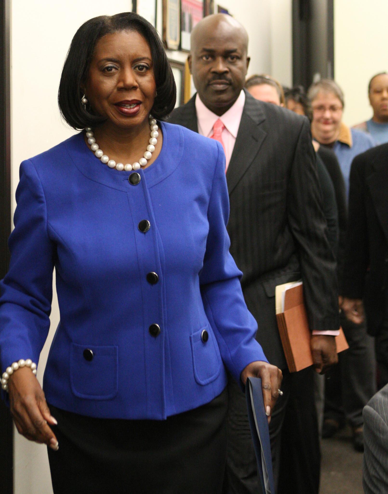 Regulators File Complaint Against Brown S Husband