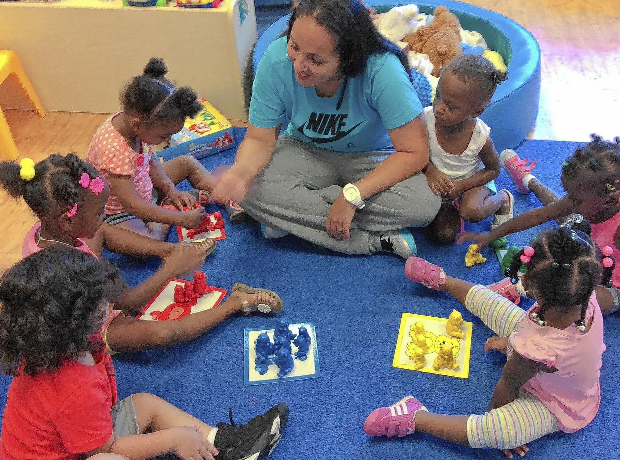 Leah De Conducts An Activity With Her Early Head Start Children At Orlando Day Nursery