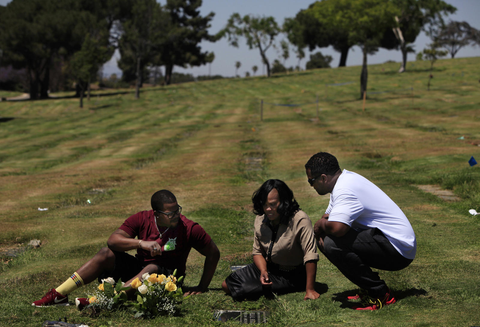 Atwan Williams, LaQuita Suggs and Solomon Ricks visit LaQuita mother's grave at the Inglewood Park Cemetery on the seventh anniversary of her death. LaQuita's mother Ella Suggs was stabbed multiple times and died April 29, 2007.