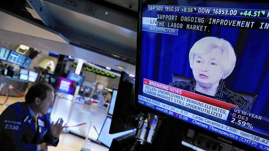 U.S. Stocks Gain as Fed Cuts Stimulus Amid Economic Recovery
