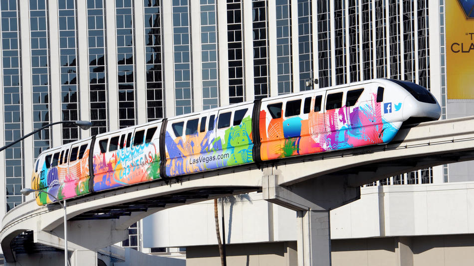 A colorful monorail train travels along Paradise Road in Las Vegas.
