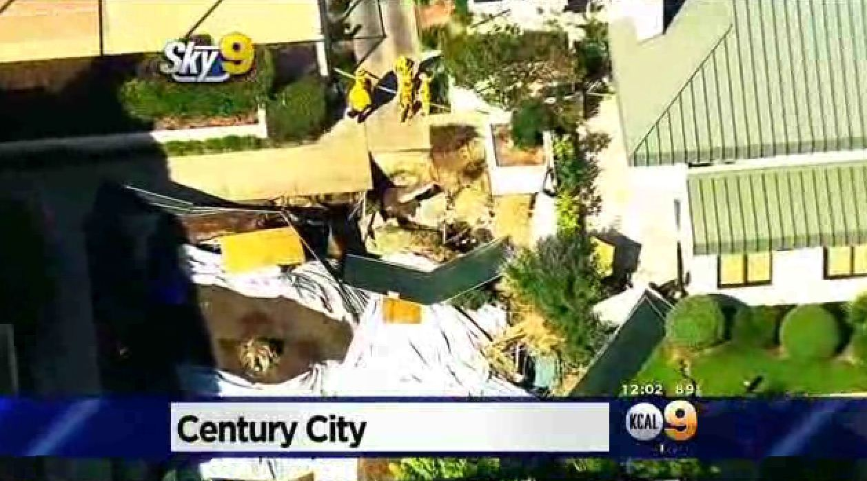 Condo parking structure partially collapses in Century ...