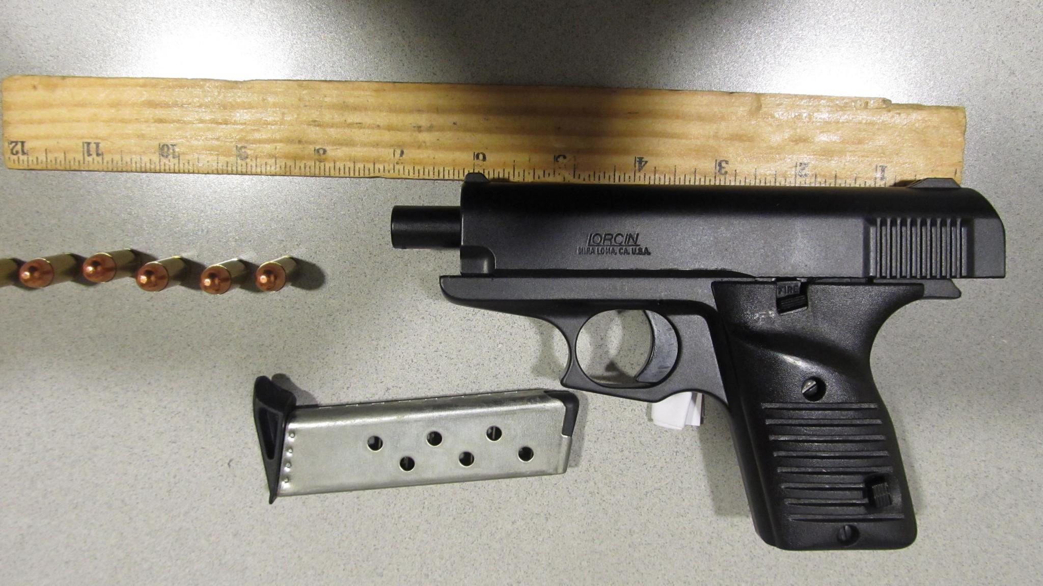 Gun found in man's carry-on
