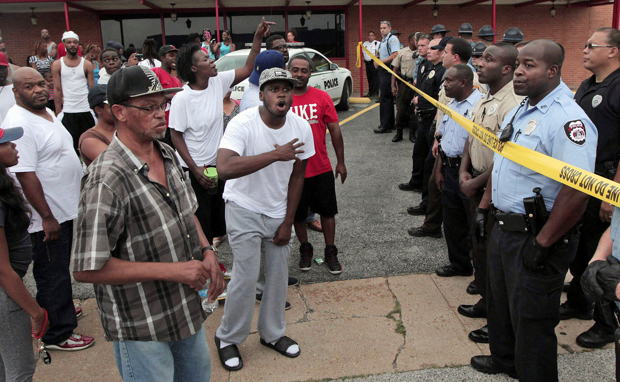 Protesters and police face off in St. Louis suburb over ...