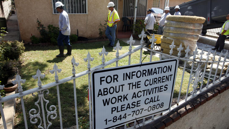 Crews work to remove lead-contaminated soil in Boyle Heights. (Mark Boster/Los Angeles Times)