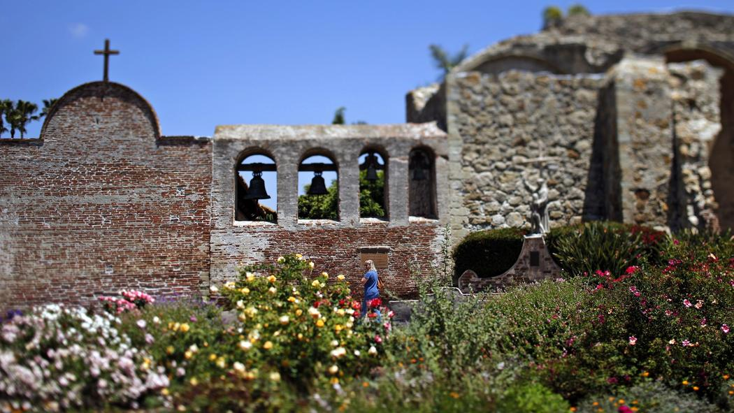 The gardens bloom near walls that are more than 200 years old.