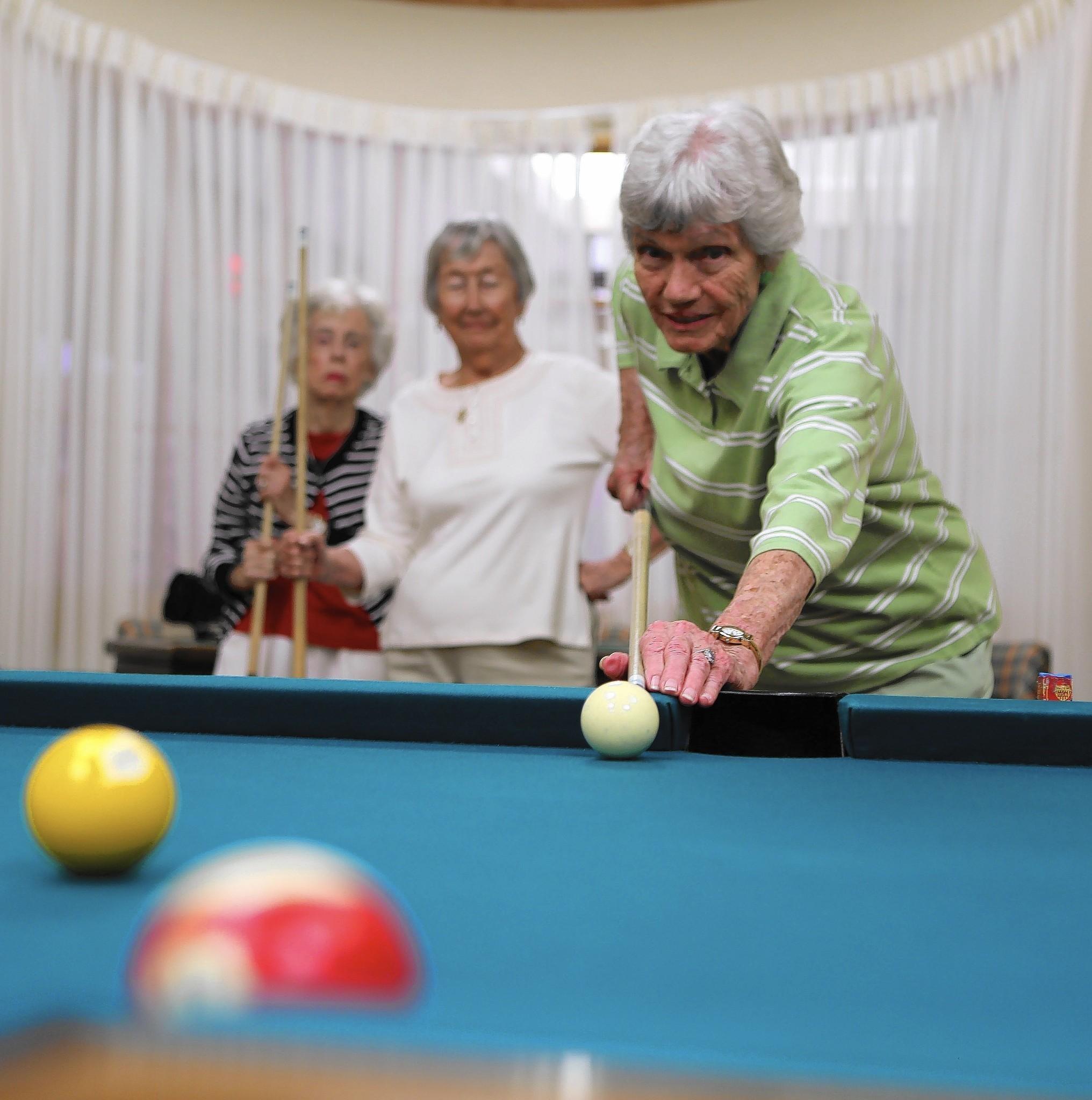 Senior Women Make A Splash At The Pool Tables At Village