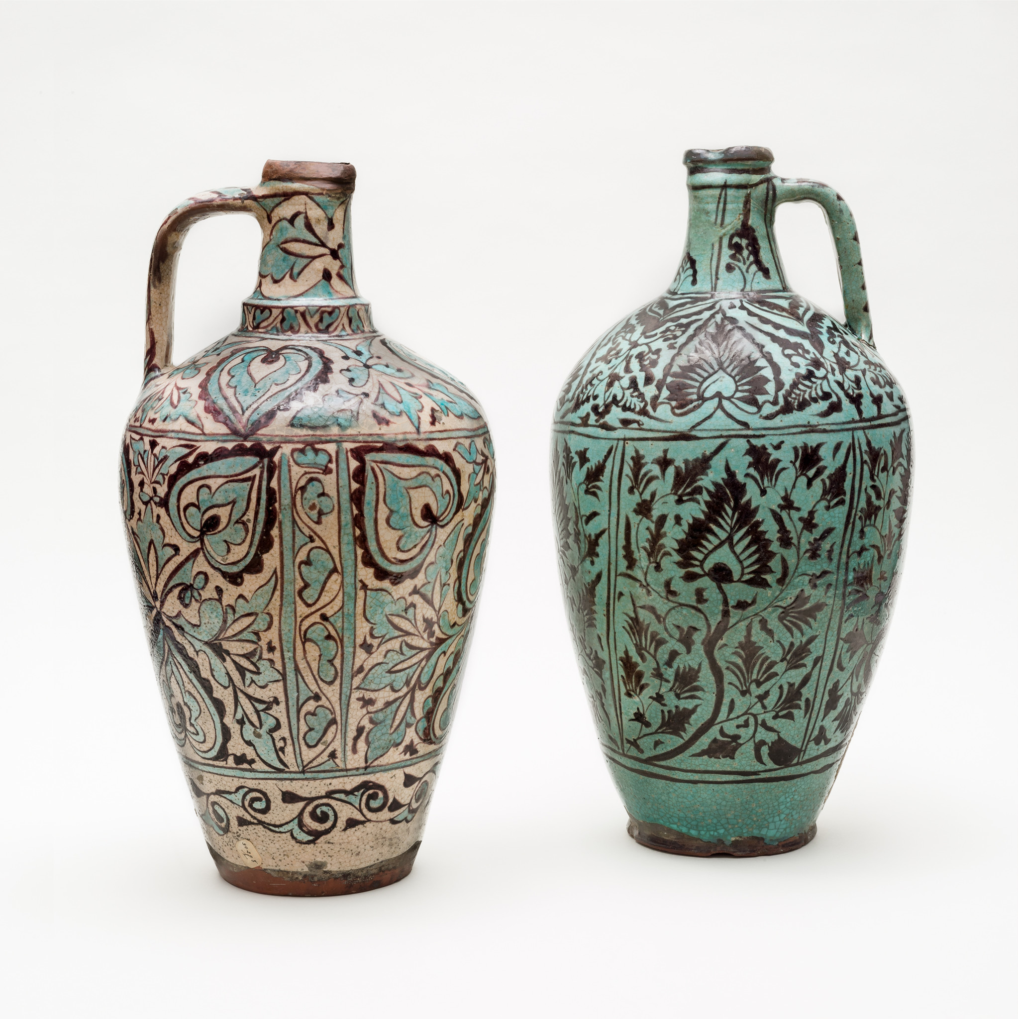 A pair of 15-16th century floral jugs from Iran