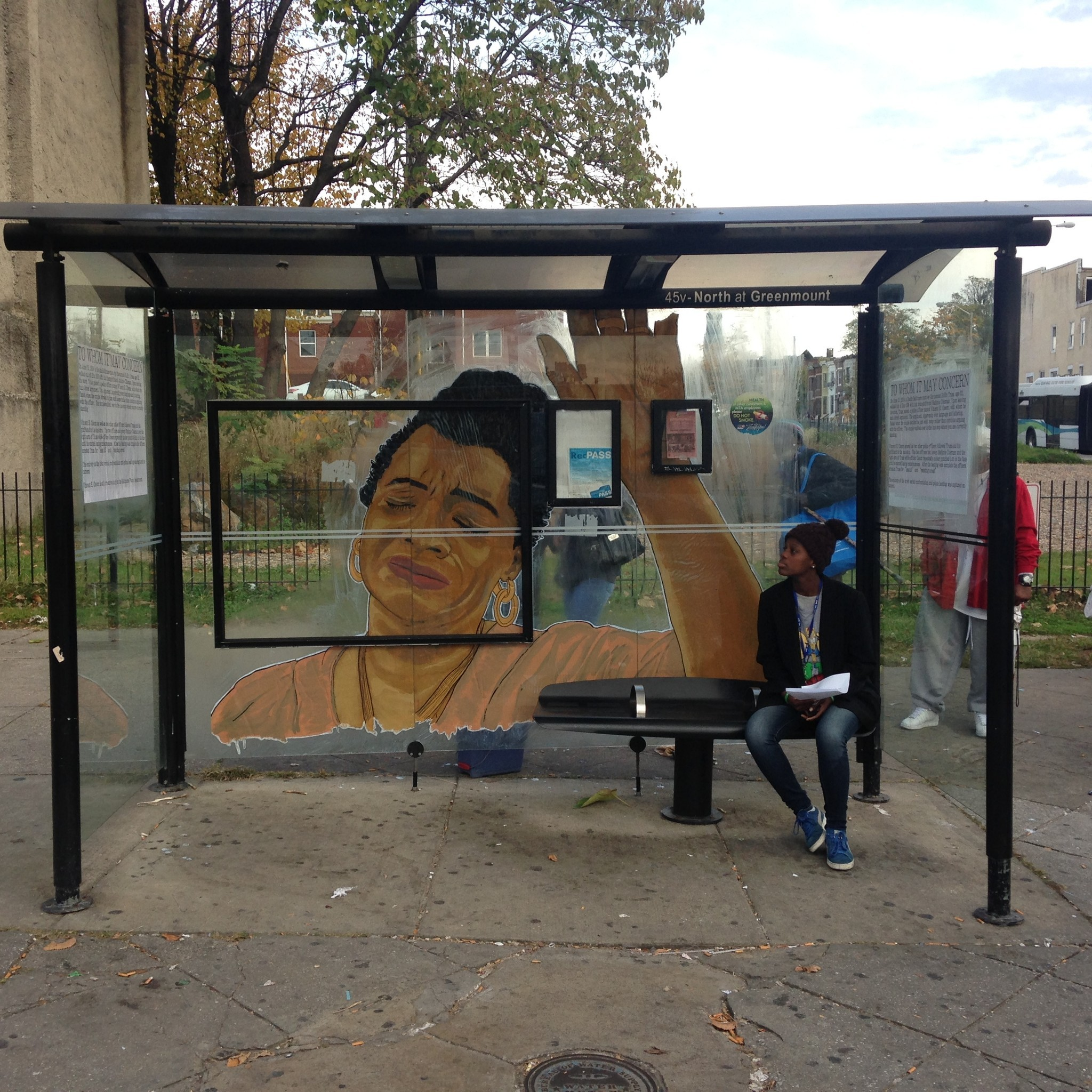 Local Street Artist Nether Creates Work On Bus Stop Where