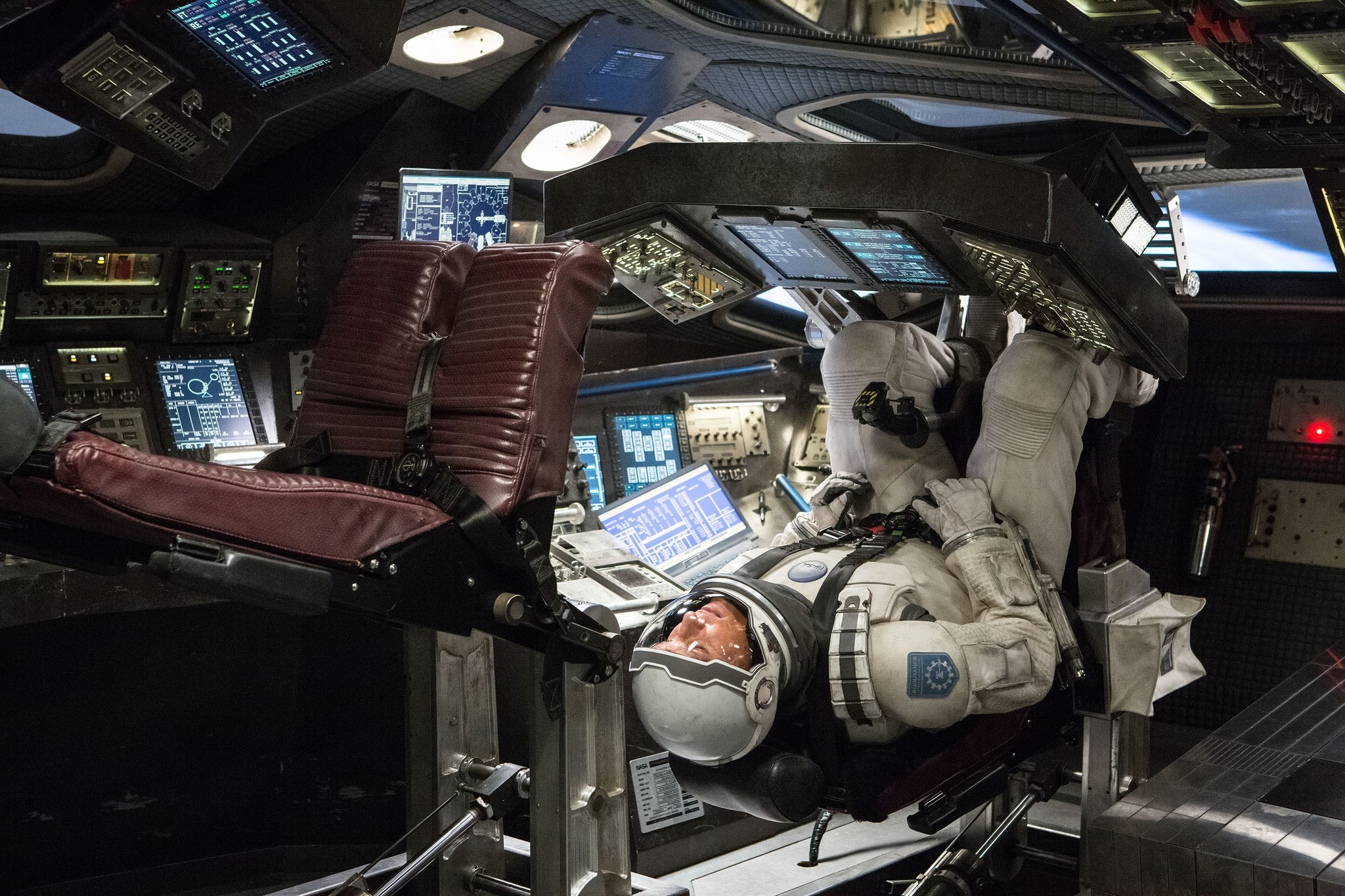 An astronaut upside down in a spaceship in this scene from