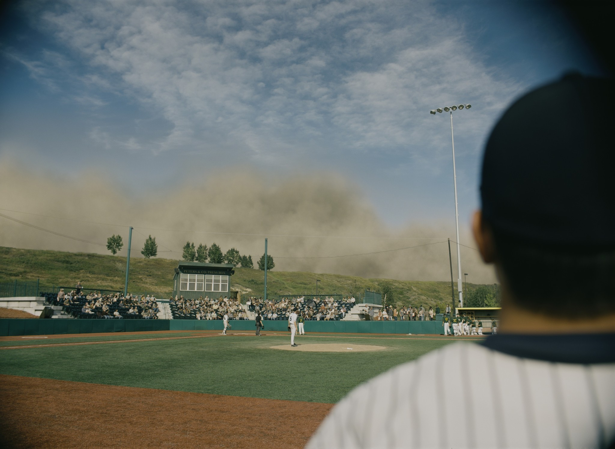 A dust storm at a baseball field in this scene from