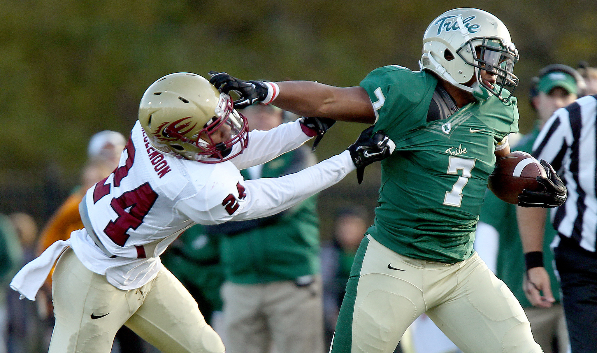 William and Mary's Mikal Abdul-Saboor tries to get past Adrian McClendon of Elon during the first quarter Saturday in Williamsburg. (Rob Ostermaier / Daily Press)