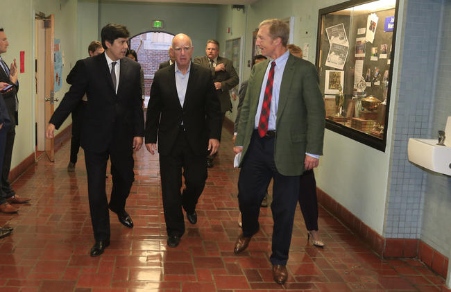 From left, Senate leader Kevin de León, Gov. Jerry Brown and Tom Steyer (Mark Boster / Los Angeles Times)