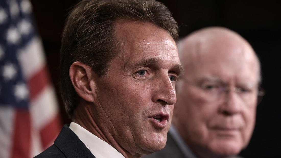 Arizona Sen. Jeff Flake, foreground, will not attend the GOP convention in Cleveland.