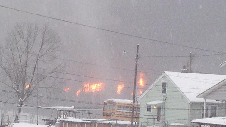 A fire burns Monday, Feb. 16 after a train derailment near Charleston, W.Va. Nearby residents were told to evacuate as state emergency response and environmental officials headed to the scene. (John Raby/AP Photo)