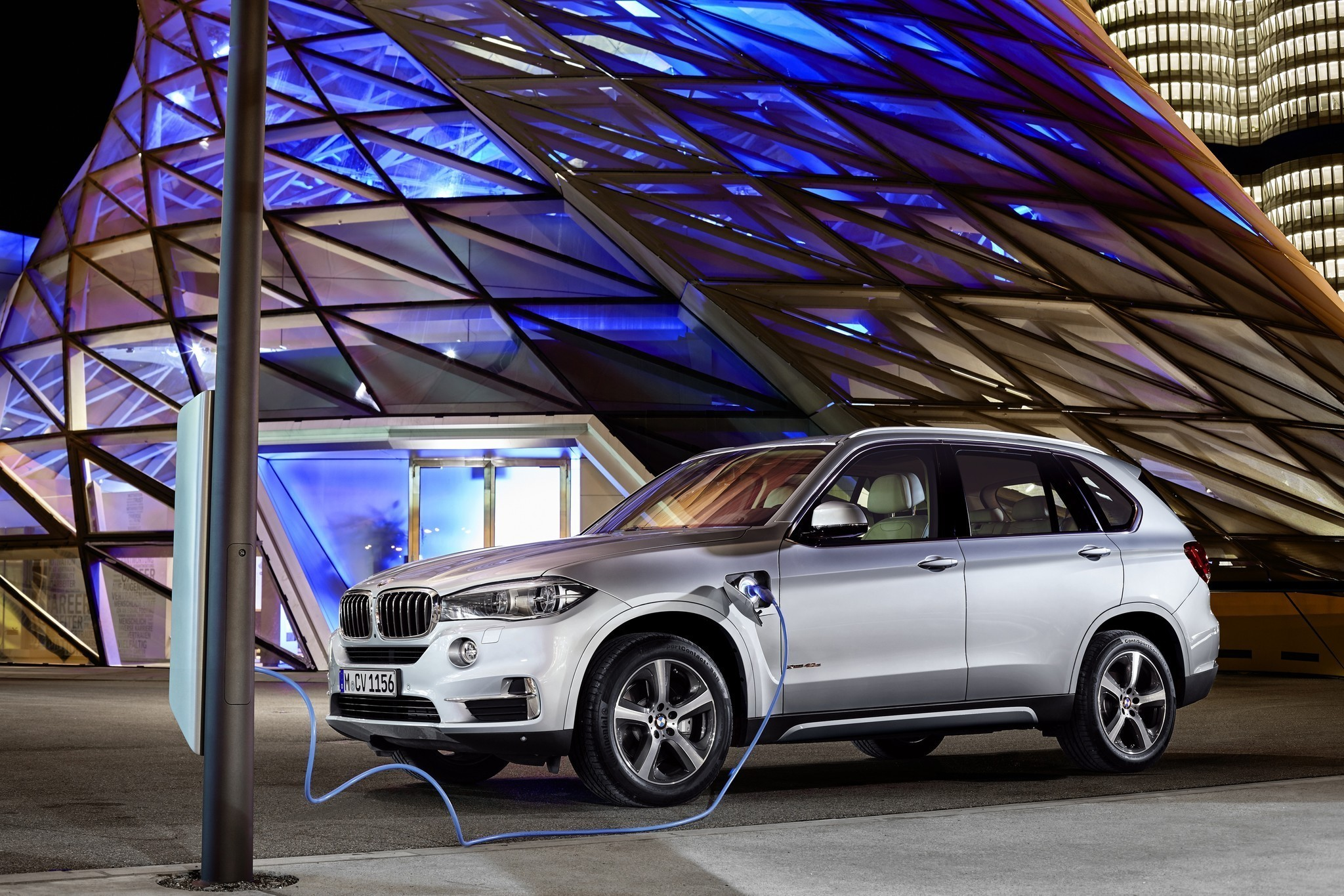 bmw to launch x5 plug in hybrid suv la times. Black Bedroom Furniture Sets. Home Design Ideas