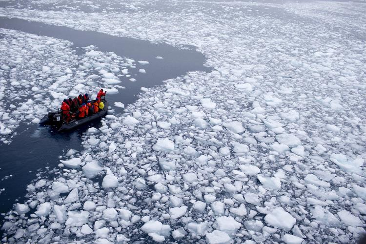 A team of scientists in Antartica in January, where ice shelves are melting faster. (Natacha Pisarenko / Associated Press)