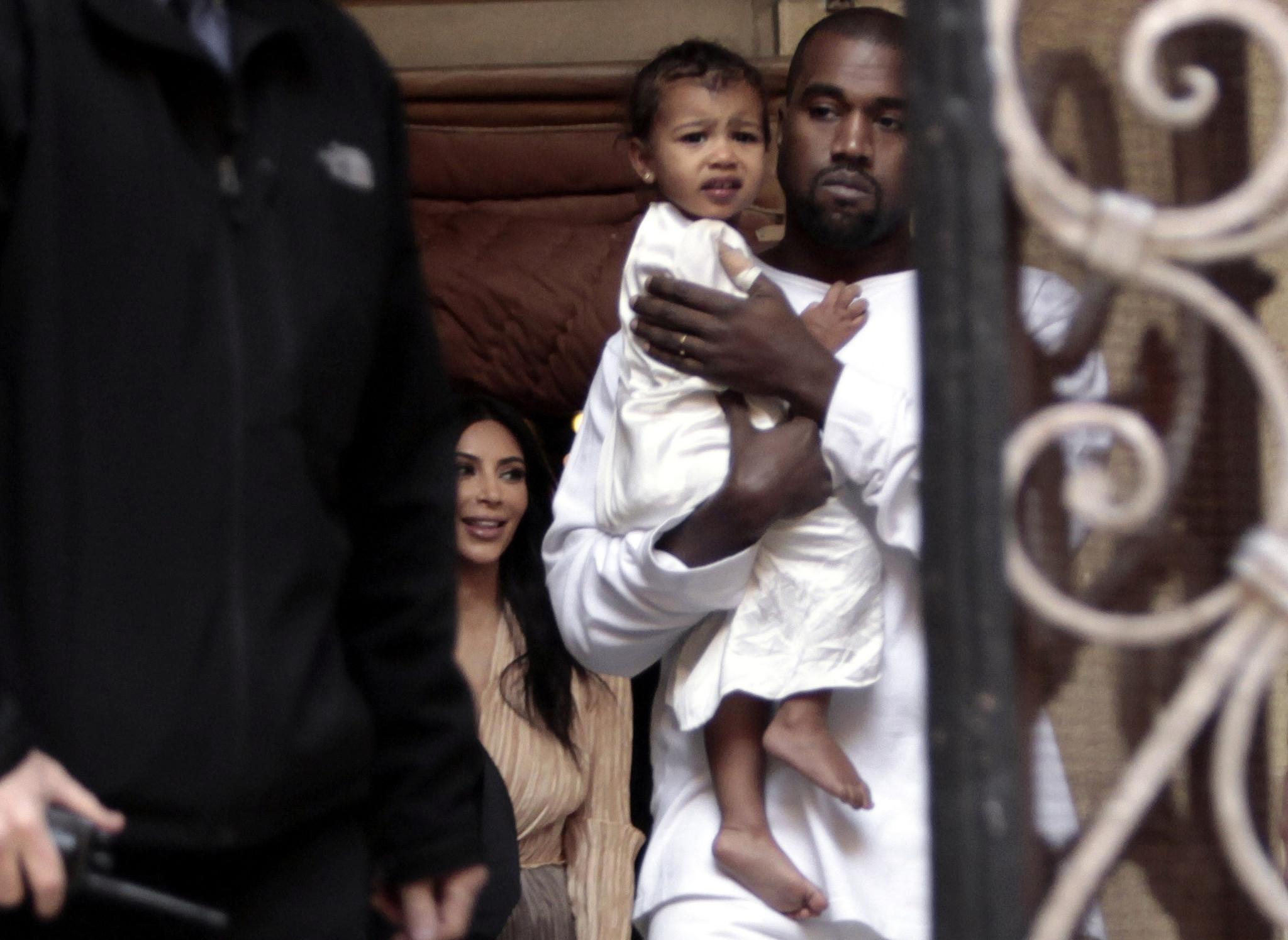 0ffce4e5b224c Kim Kardashian and Kanye West have baby baptized in Jerusalem - Chicago  Tribune
