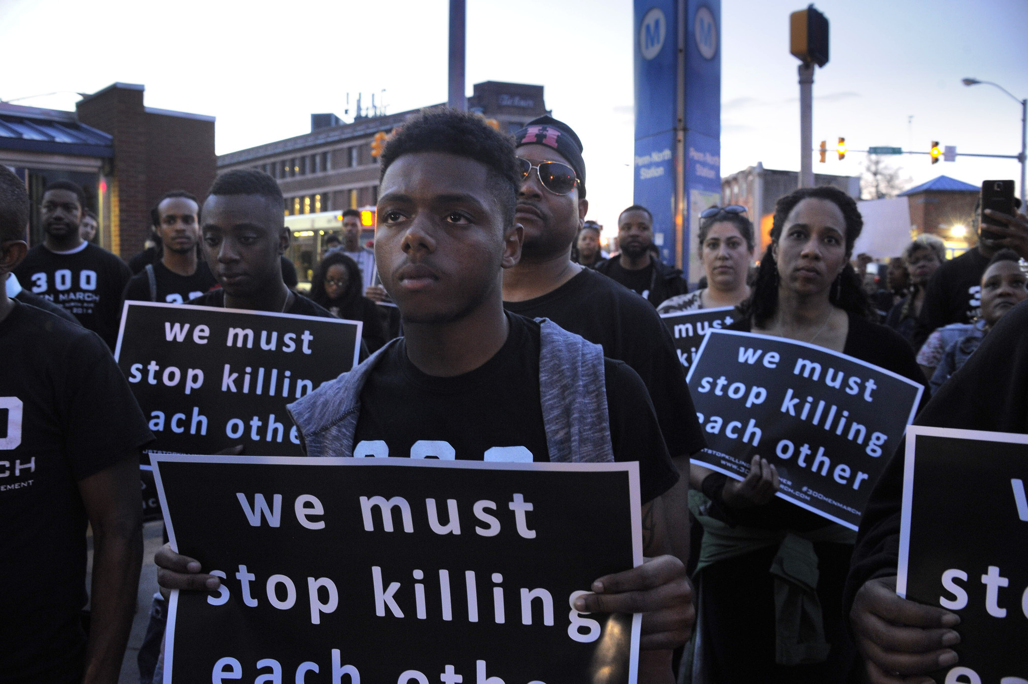 Street-corner rally appeals for residents to 'stop killing ...