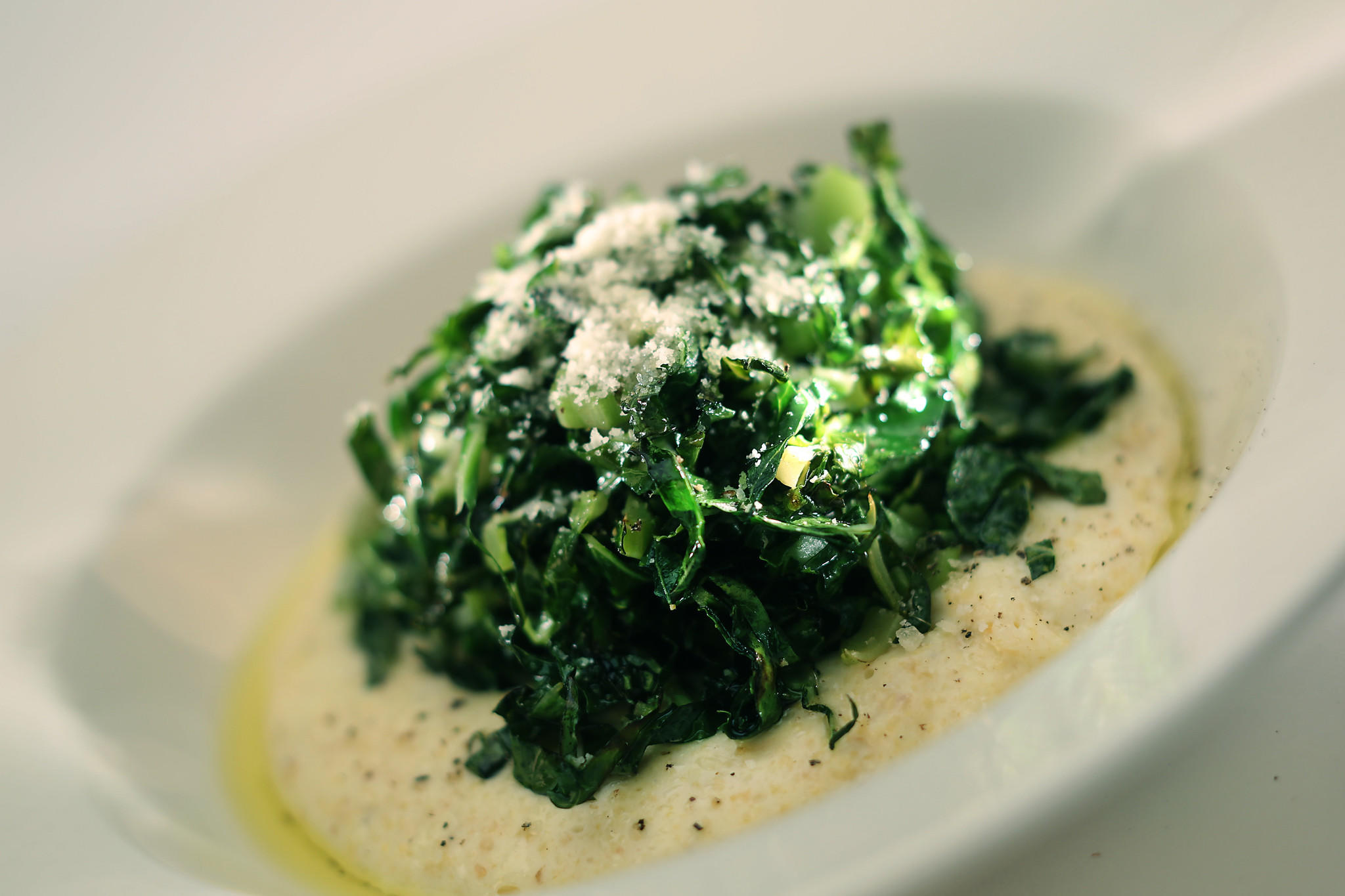 Sautéed cauliflower leaves with soft mascarpone polenta