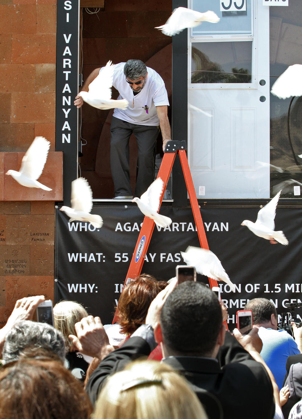 <p>Agasi Vartanyan emerges from a glass enclosureat St. Leon Cathedral in Burbank on Thursday, May 28, 2015, where he fasted for 55 days to commemorate the 100th anniversary of the Armenian Genocide.</p>