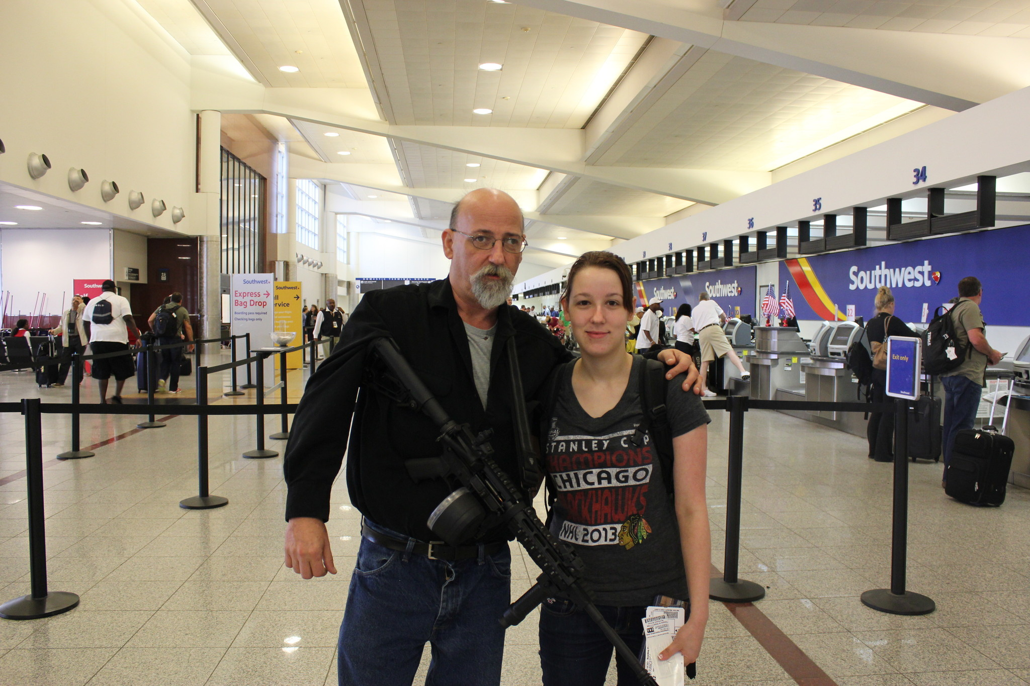 Law allows man to carry loaded assault rifle through ...