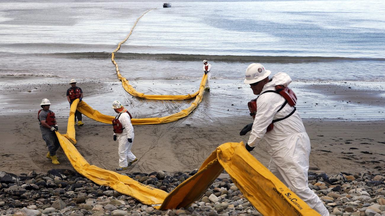 Workers prepare an oil containment boom at Refugio State Beach after May's oil spill north of Santa Barbara. (Jae C. Hong / Associated Press)