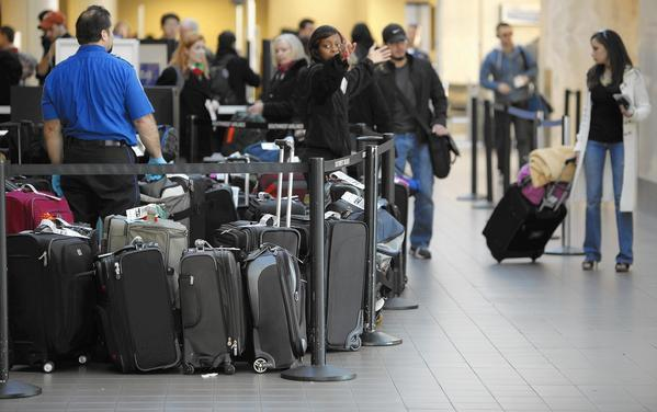 Image result for TSA, person with tons of luggage