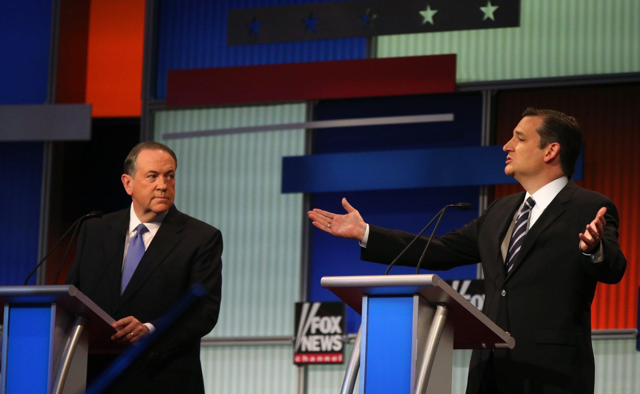 Texas Sen. Ted Cruz speaks as former Arkansas Gov. Mike Huckabee listens. (Andrew Harnik / Associated Press)