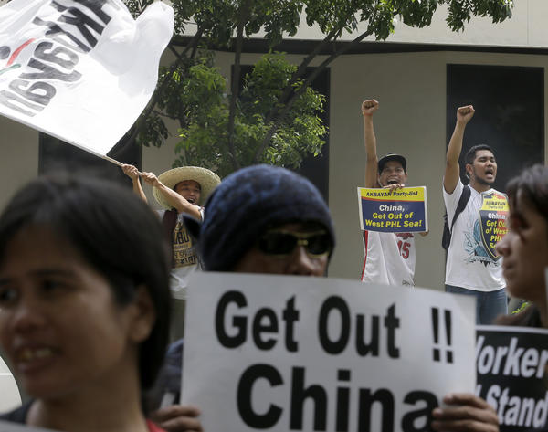 Demonstrators gather outside a Chinese consulate in the Philippines in July to protest the building of artificial islands in the South China Sea. (Bullit Marquez / Associated Press)