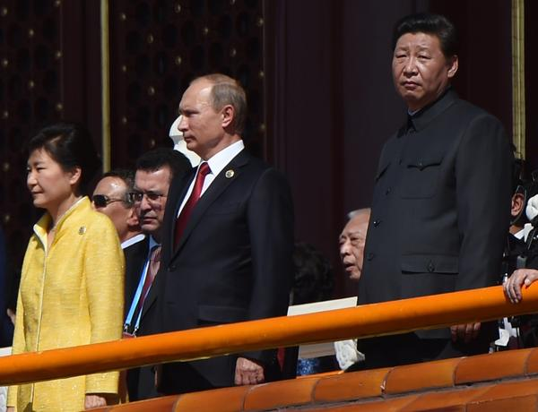 Chinese President Xi Jinping, right, with Russian President Vladimir Putin and South Korean President Park Geun-hye at the parade. (Greg Baker / AFP/Getty Images)