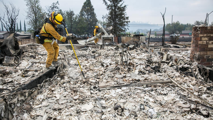 Firefighters look for hotspots on Monday after the Valley fire destroyed homes in Middletown, Calif. (Marcus Yam / Los Angeles times)