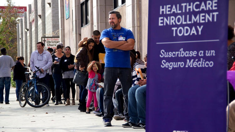 People wait to enter an Affordable Care Act enrollment event sponsored by SEIU-United Healthcare Workers West and Community Coalition in Los Angeles. (Michael Chavez / Associated Press) ()