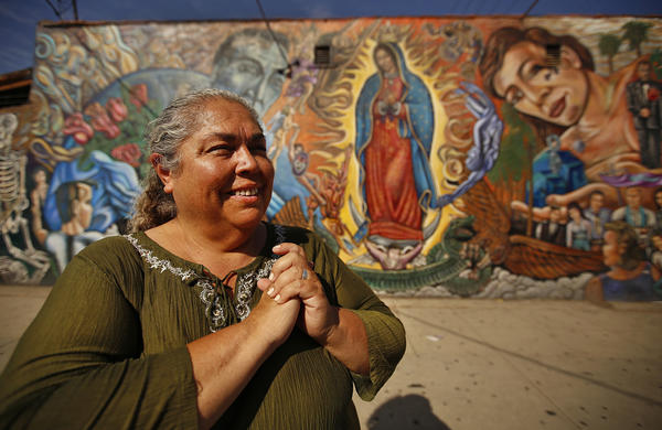 Rosa Manriquez, a lector, is travellng to Philadelphia. (Al Sieb / Los Angeles Times)