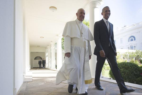 President Obama and Pope Francis walk to a meeting in the Oval Office. (Mandel Ngan / AFP/Getty Images)