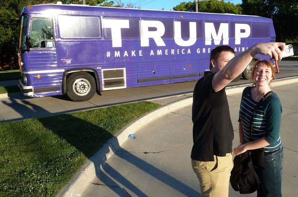 People take a photograph in front of a Donald Trump campaign bus in Urbandale, Iowa. (Michael Mathes/AFP/Getty Images)