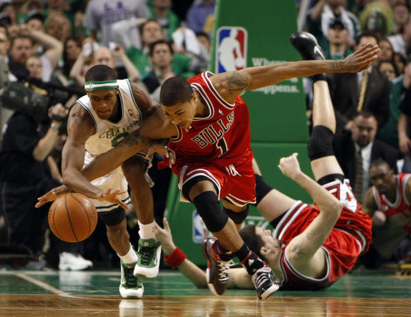 3a49cb942dac Derrick Rose and the Celtics  Rajon Rondo battle for ball in 4th quarter  during Bulls  105-103 overtime win during Game 1 of Eastern Conference ...