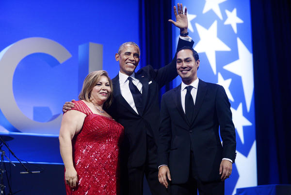 President Obama, Rep. Linda Sanchez (D-Whittier), and HUD Secretary Julian Castro (Olivier Douliery / Getty Images)
