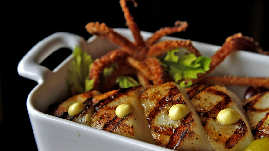 White Oak grilled sword squid with marinated gigande beans and lemon curd from Manhattan Beach Post.