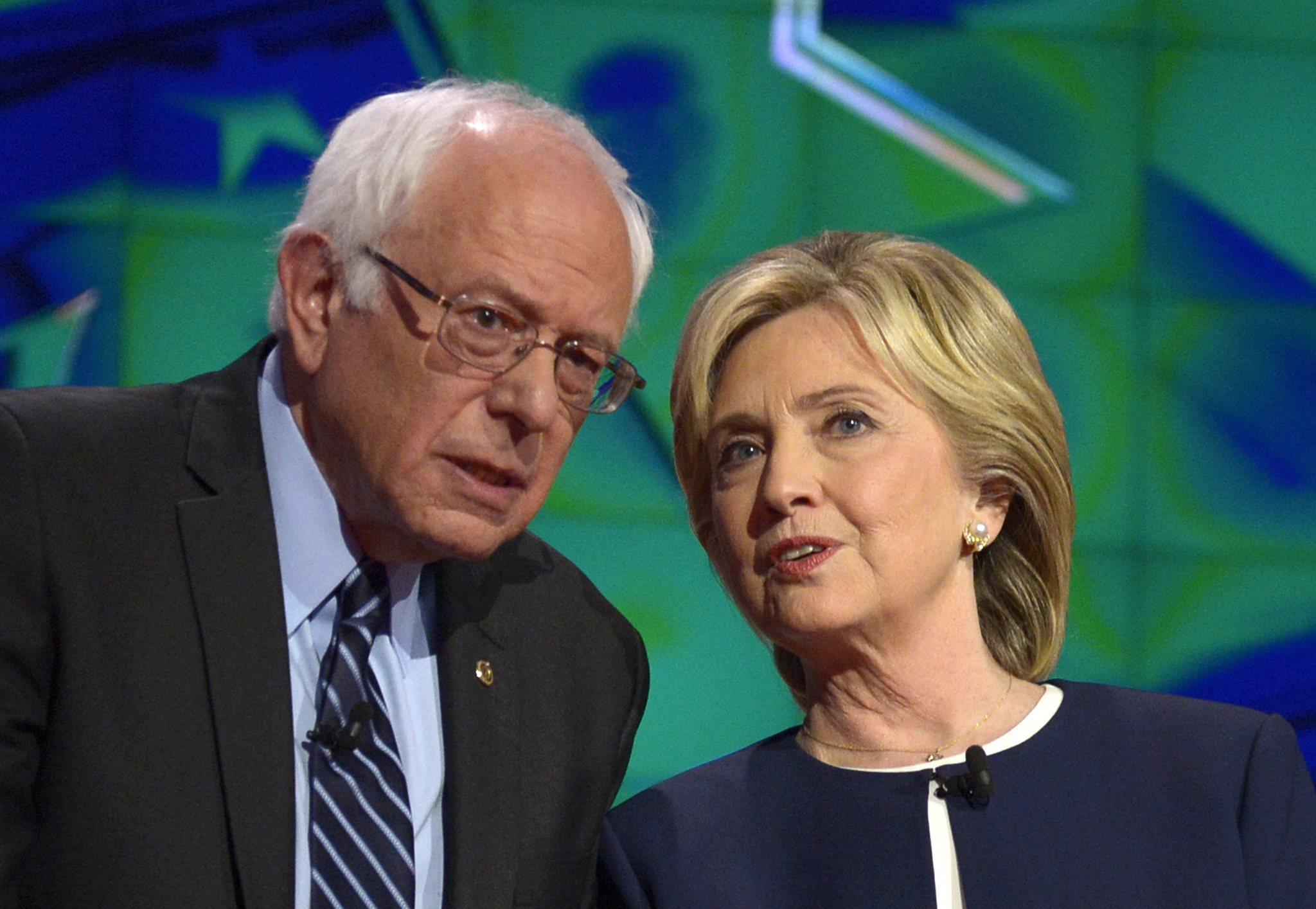 Sen. Bernie Sanders (I-Vt.) and former Secretary of State Hillary Rodham Clinton talk before the start of the Democratic presidential debate in Las Vegas last month. (Mike Nelson / EPA)