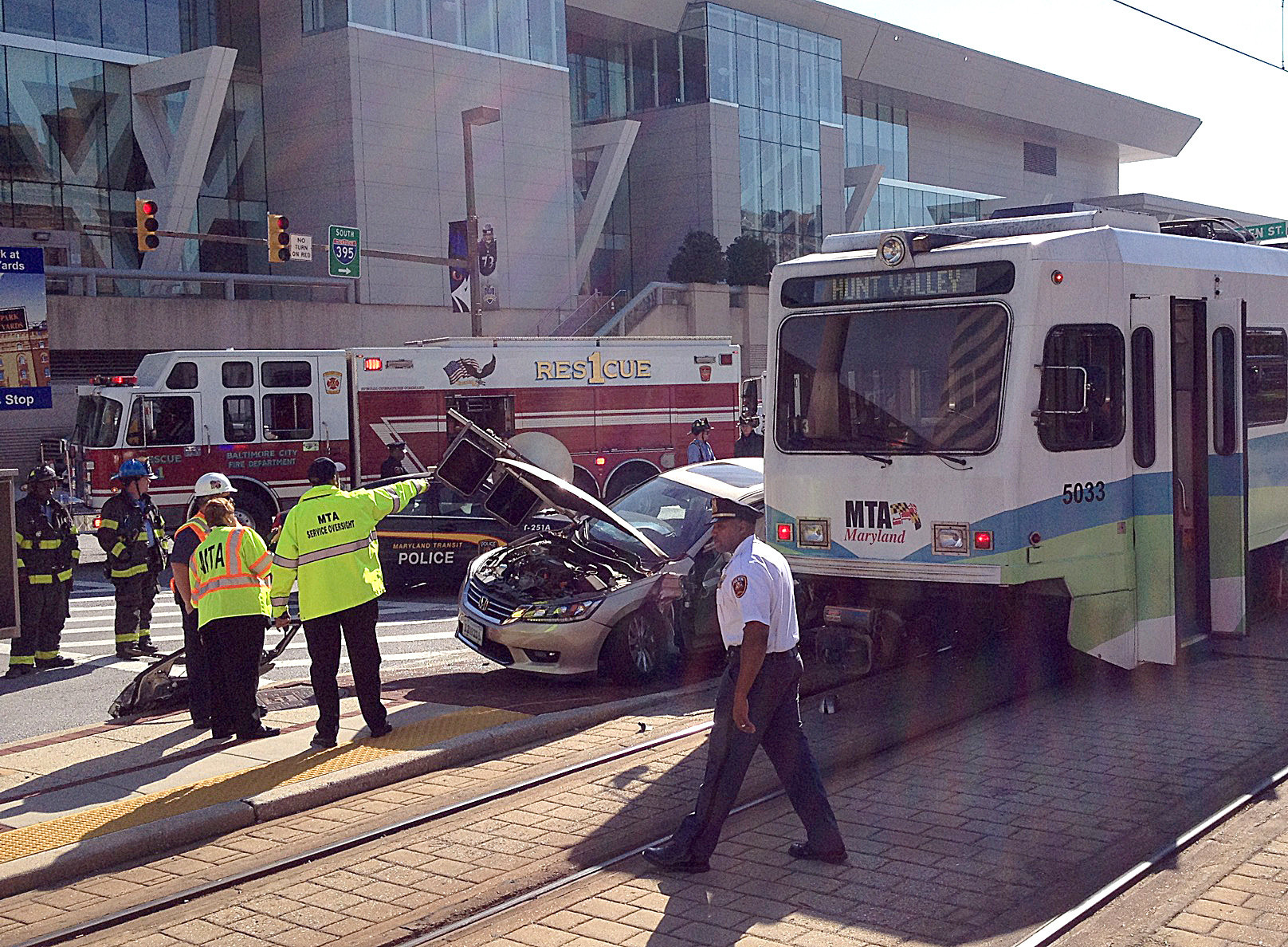 Passengers trapped after car collides with Light Rail train