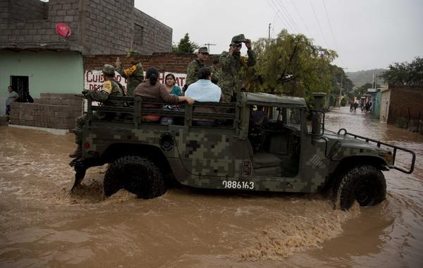 Soldiers evacuate residents to a shelter in Zoatlan, Nayarit state, about 90 miles northwest of Guadalajara, Mexico. (Associated Press)