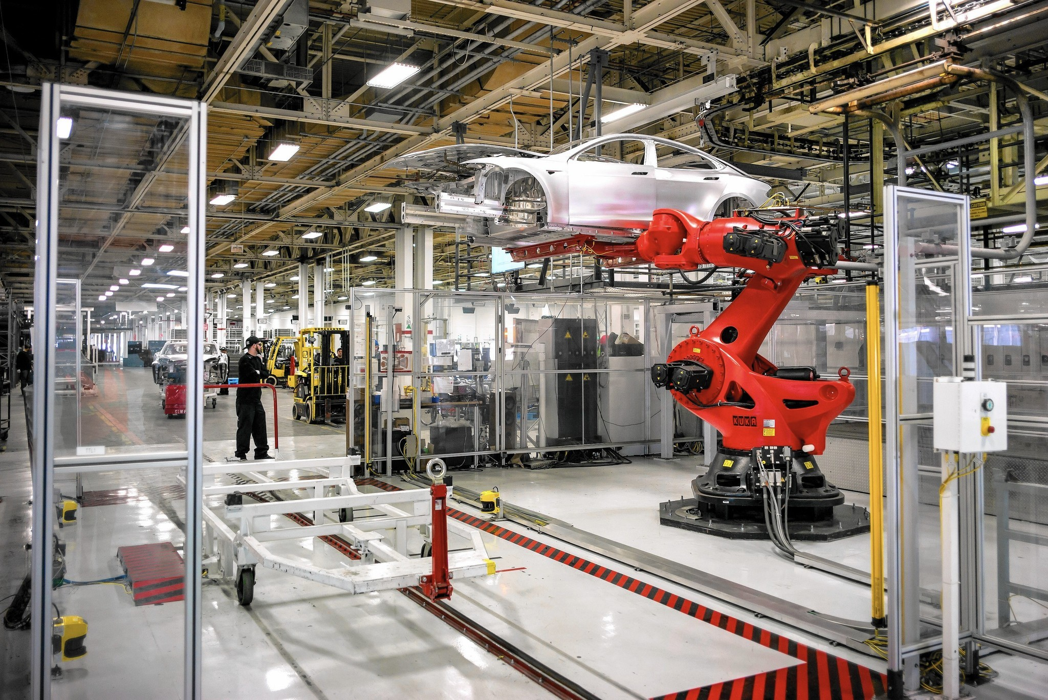 Scenes from the Tesla car factory. (David Butow / For the Times)