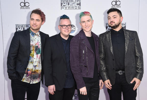 Walk the Moon arrives at the 2015 American Music Awards at Microsoft Theater on Sunday. (Jason Merritt / Getty Images)