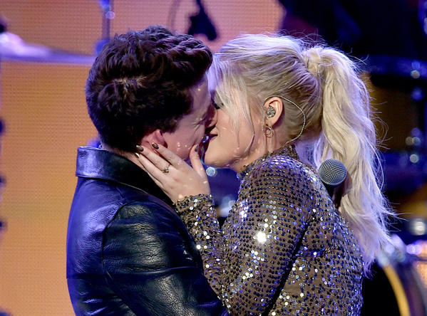 Singers Charlie Puth and Meghan Trainor kiss onstage, something they've done before. (Kevin Winter / Getty Images)