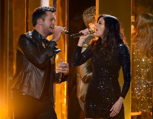 Singers Luke Bryan and Karen Fairchild perform onstage during the 2015 American Music Awards at Microsoft Theater. (Kevin Winter/Getty Images)